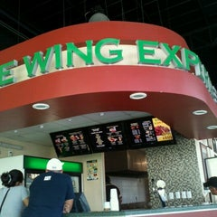Photo taken at Wingstop by Gina Q. on 6/9/2012