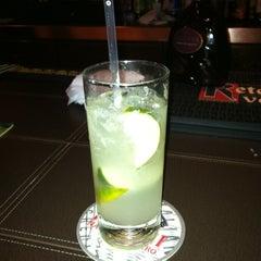Photo taken at Mompou Tapas Bar & Lounge by Whitney D. on 10/9/2011