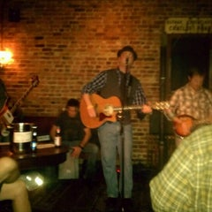 Photo taken at 11th Street Bar by East Village Eats on 12/8/2011