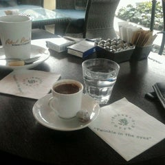 Photo taken at Robert's Coffee by Emrah T. on 3/2/2012