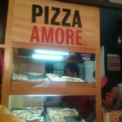 Photo taken at Pizza Amore by enrique v. on 7/22/2012