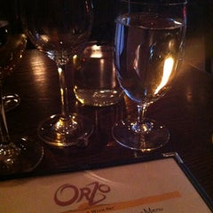 Photo taken at Orzo Kitchen & Wine Bar by Emily A. on 7/12/2012