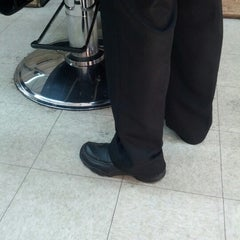 Photo taken at Sigfrido Barber Shop by Cesar R. on 8/16/2012
