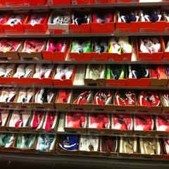 Photo taken at Nike Factory Store by Nikki A. on 5/19/2012