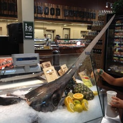 Photo taken at Whole Foods Market by Megan B. on 7/16/2012