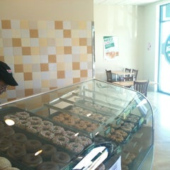 Photo taken at Krispy Kreme Doughnuts by Jake S. on 5/10/2012