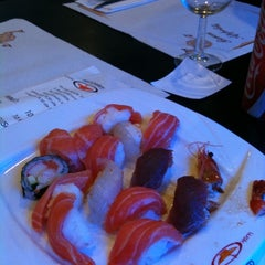 Photo taken at Wok Sushi by Claudia C. on 7/24/2011