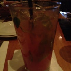 Photo taken at Flame Rotisserie Grill & Bar by Sam on 2/19/2012