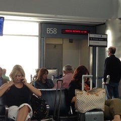 Photo taken at Gate B58 by Scott F. on 8/20/2012