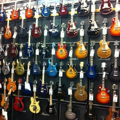Photo taken at Guitar Center by Nicole S. on 2/26/2012