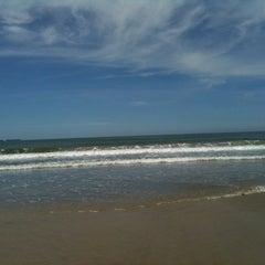 Photo taken at Praia de Imbé by Giovana G. on 4/7/2012