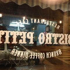 Photo taken at Bistro Petit by Ryan M. on 3/22/2012