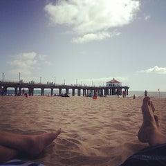 Photo taken at Manhattan Beach by Edgar R. on 5/26/2012