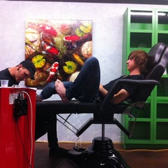 Photo taken at Tribe Tattoo by Steven S. on 4/3/2012