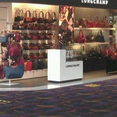 Photo taken at Longchamp by Cyn H. on 12/2/2011