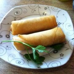 Photo taken at Green Papaya by Cindy H. on 3/22/2012