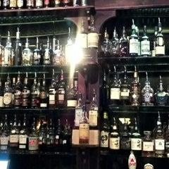 Photo taken at Downing Street Pub & Cigar Bar by James B. on 7/14/2012