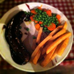 Photo taken at Tizi's Restaurant & Bar by Falihati K. on 7/7/2012