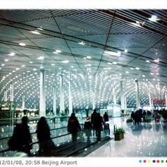 Photo taken at Beijing Capital Int'l Airport 北京首都国际机场 (PEK) by Tagosaku J. on 1/8/2012