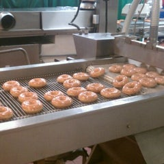 Photo taken at Krispy Kreme Doughnuts by Chris on 1/22/2012