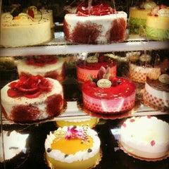 Photo taken at Porto's Bakery & Cafe by Claudia E. on 8/23/2012