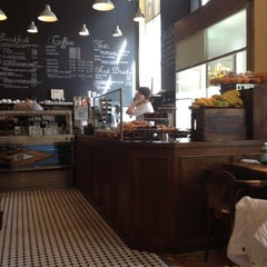 Photo taken at Le Gourmand Café by Lisa C. on 7/8/2012
