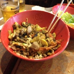 Photo taken at Genghis Grill by Tricia S. on 3/26/2012