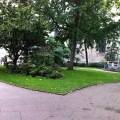 Photo taken at St Paul's Churchyard by Marcelo Y. on 7/20/2012