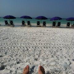 Photo taken at Miramar Beach by Devan P. on 7/3/2012