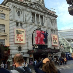 Photo taken at Victoria Palace Theatre by Charlotte R. on 8/2/2012