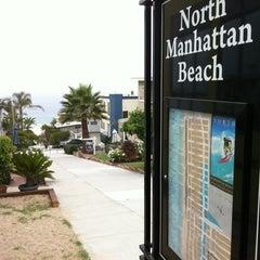 Photo taken at Manhattan Beach by *pauline* on 6/29/2012