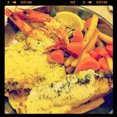 Photo taken at The Manhattan Fish Market by Isabelle L. on 11/10/2011
