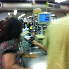Photo taken at Carrefour Bairro by Jorge T. on 5/10/2012