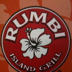 Photo taken at Rumbi Island Grill by Dominique D. on 1/30/2011