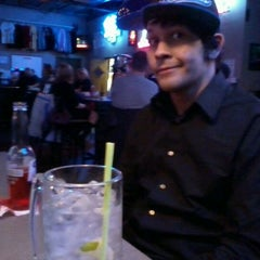 Photo taken at Woody's Bar by Rachel S. on 12/31/2011