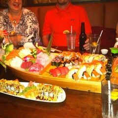 Photo taken at Sushi Thai Too by Michelle D. on 1/1/2012