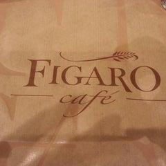 Photo taken at Figaro Café by Priscilla V. on 8/31/2012