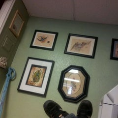 Photo taken at 24 Hour Tattoo by Paul H. on 5/6/2012