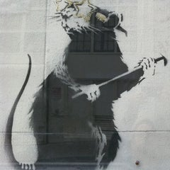 Photo taken at Banksy Mural: 'Glitter Glasses' Rat by Mike M. on 8/17/2011