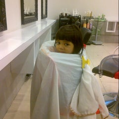 Photo taken at Peek-a-boo Hair Salon by Jaja A. on 8/18/2012