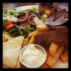 Photo taken at Ammos Authentic Greek Cuisine by Carrie L. on 9/2/2012