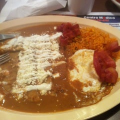 Photo taken at Tío Luis Tacos by Janet R. on 12/29/2011
