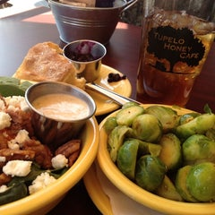 Photo taken at Tupelo Honey Cafe by Julie N. on 3/19/2012