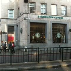 Photo taken at Starbucks by Angus M. on 11/19/2011