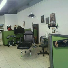 Photo taken at Rolling Stone Tattoo by Dusty M. on 10/1/2011