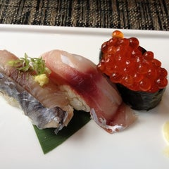 Photo taken at Sushi Taro by Robin S. on 7/21/2012