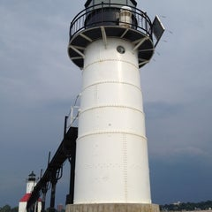 Photo taken at St. Joseph South Pier (at Silver Beach) by Jenn on 7/14/2012