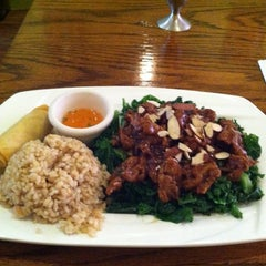 Photo taken at Wild Ginger Pan-Asian Vegan Cafe by Eric G. on 6/8/2012