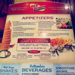 Photo taken at Red Robin Gourmet Burgers by Courtney on 8/12/2012