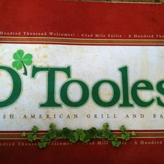 Photo taken at O'Tooles Irish American Grill & Bar by Hannah M. on 7/29/2012